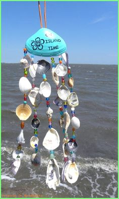 Sea Shell Wind Chime, Beach Chime, On Island Time, Painted Shell, Beaded Windchime - This wind chime is unique in that it has glass beads as well as shells in its strands. The base clam - Seashell Wind Chimes, Diy Wind Chimes, Seashell Art, Beach Crafts, Crafts To Make, Diy Crafts, Seashell Projects, Seashell Crafts Kids, Driftwood Projects