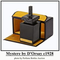 Mystere by D'Orsay: launched in black glass square shaped bottle, the stopper is molded w/ lizards.Bottle marked R tall.(Photo from Perfume Bottles Auction) Lalique Perfume Bottle, Antique Perfume Bottles, Vintage Bottles, Blue Bottle, Bottle Art, Pacifica Perfume, Black Perfume, Popular Perfumes, Vintage Vanity