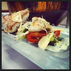 Seared snapper, roasted tomato and onion salad with coconut mint dressing