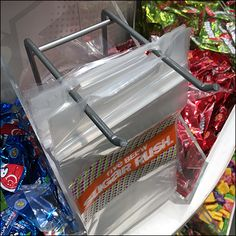 Appropriately named and strategically placed directly among the offerings, this Candy Bulk-Bin Bag Dispenser Built-In strategy encourages shopping. Retail Fixtures, Store Fixtures, All Candy, Bin Bag, Candy Store, Random, Building, Bags, Handbags