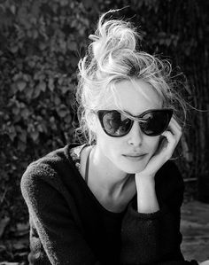 You can't beat a cat's eye sunglass, black and a top knot when on the road…