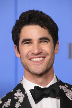 Darren Criss poses in the press room during the 76th Annual Golden...