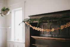 Slice an orange very thinly, dry the rounds, and secure it on a garland. | 15 Borderline Genius Christmas Decorating Ideas For Your Tiny Space