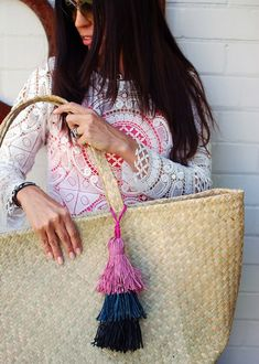 Learn how to make a designer-style layered raffia tassel.