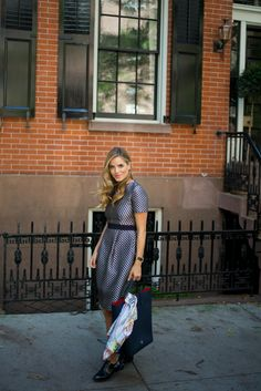 Gal Meets Glam Julia Engel in CH Carolina Herrera polka dot dress & navy editor tote