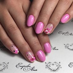 2017 The nail design is pink decorated with a round glitter.