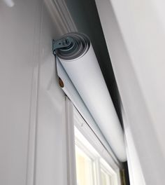 vinyl roll up blinds-hide behind sheer curtains