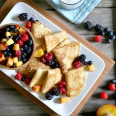Lemon Crepes with a cream cheese + honey spread. Served with fresh fruit.