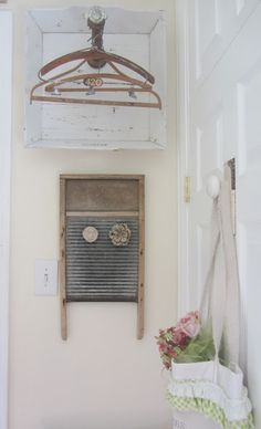 Junk Chic Cottage: Laundry Room--I took an old sewing spool and added an old crystal door knob to the end and hung my old vintage laundry hangers on it.  My friend had given me this old magnetic wash board for my birthday. Junk Chic Cottage, Cottage Living, Vintage Ironing Boards, Burlap Window Treatments, Laundry Hanger, Crystal Door Knobs, Vintage Laundry, Small Laundry Rooms, Vintage Pillows