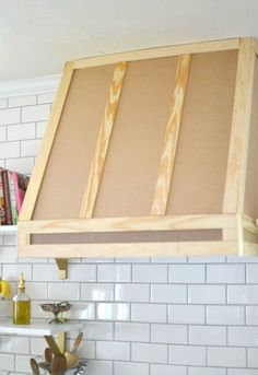 Woodworking how i built a range hood cover, diy, kitchen design, woodworking projects - When we moved into our home the wall behind our stove was dominated by heavy, imposing cabinetry that made the ceiling feel low and the room feel cramped. Home Design Diy, Küchen Design, Diy Home Decor, Design Ideas, Cover Design, Range Hood Cover, Range Hoods, Range Hood Fan, Range Vent