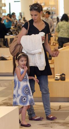 Katie Holmes and Suri in matching plum-colored Bloch flats. Find matching styles at meNmommy.com