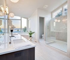 Here's a great example of a contemporary master bathroom with large glass walk-in shower, double sink vanity, large white space and tub. Large is the current trend with today's en suites. I love all the windows too, which isn't too common for bathrooms. Modern Master Bathroom Design, Bathroom Interior Design, Modern Master Bathroom, Modern Bathroom Design, Contemporary Master Bathroom, Bathroom Design Luxury, Luxury Bathroom, Bathroom Decor, Beautiful Bathrooms