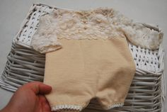 Gorgeous newborn girl romper, made of soft and stretchy knit fabric, beige colour for bottom and on the top part it has cream textured lace.