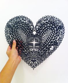 Handcut Paper Heart by Ariadine on Etsy.