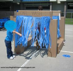 Working at the Car Wash in Preschool::Teaching The Little People  Blue tablecloth and boxes- fun summer activity!