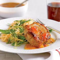 This Asian-style 30-minute meal pairs ginger and apricot sauced pork chops with a pasta and snow pea side dish.