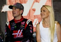 Gene Haas, co-owner of Stewart-Haas Racing with Tony Stewart, hired Kurt Busch and funded a fourth Stewart-Haas car for him in 2014. Here, Busch, driver of the No. 41 Haas Automation Chevrolet, stands on pit road with then-girlfriend Patricia Driscoll after qualifying for the Chase for the Sprint Cup during the NASCAR Sprint Cup Series Federated Auto Parts 400 at Richmond International Raceway on Sept. 6, 2014, in Richmond, Virginia.