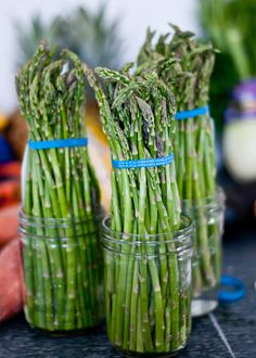 The best way to store ASPARAGUS is to cut 1/4″ off the bottom of the stalks and store them upright in a little water.