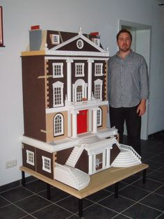 My Grosvenor Hall from the Dollshouse Emporium ... this picture with my hubby next to it gives quite a good idea of how tall it is
