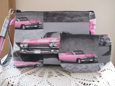 """Pouch Clutch Wristlet Zipper Bag Set Smart phone Case Pink Cadillac is a new larger style wristlet to accommodate those Smart phones. This one will do the trick with room to spare.    This little bag is roomy enough for your sunglasses, a small camera, cell phone, Iphone, Blackberry, GPS or Ipod to fit comfortably.    This set features pink Cadillac s from the vintage 50's    Measurements:  7 1/2"""" in length  5"""" height  1 1/2"""" deep    All of my bags are individually handmade, therefore the…"""
