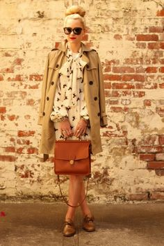 classic: love the purse and the coat. She's very unique by pulling together all the classic elements. Lovely.