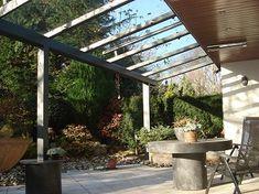 Veranda aan een woonhuis te Veghel. Veranda voorzien van gelaagd helder glas. Kleur Ral 7016 antracietgrijs met structuurlak.