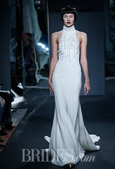 Brides.com: Mark Zunino for Kleinfeld - 2014. Style 82, silk crepe halter sheath wedding dress with rock crystal encrusted collar, Mark Zunino for Kleinfeld
