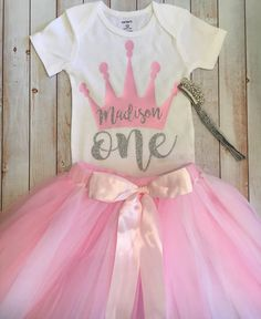Dress your princess with this beautiful glitter custom made onesie, tutu, and headband. Perfect for her first Birthday. Tutu will fit 12-18 months and is made with elastic so it can stretch. Sizes are as follow: 6 months 9 months 12 months 18 months 24 months *3 Piece set includes shirt, tutu and headband Please allow 5-10 for your custom order to be made and another 3-5 days to receive using first class shipping. Add rush/upgrade shipping to your order and receive your custom order ...