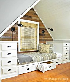 Build this cozy built in bed with stock kitchen cabinet. Add trundle drawers for more storage Instructions on how we made a built-in bed that fit into a dormer using stock kitchen cabinets. The wall behind the bed gets a rustic wood planked treatment Built In Bed, Built Ins, Wallet Minimalist, Stock Kitchen Cabinets, Old Wooden Chairs, Rooms Ideas, Bed Ideas, Attic Bedroom Designs, Attic Rooms
