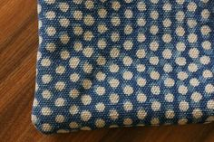 Made out of our traditional indigo designs, using only our natural dye, the cushions are a must-have for every setting. These prints are made from woodcut blocks. DETAILS Size: 40 x 40 cm; 16 x 16 in Material: Cotton Rug on both sides Color: Indigo with White Polka Dots Handmade with