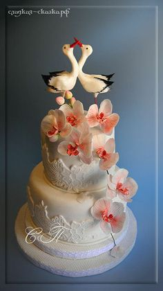 Wedding cake with storks and orchids
