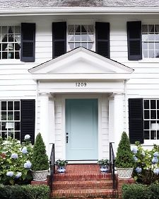 white house black shutters blue door