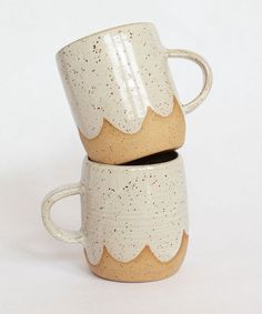 Handmade on the potter's wheel from speckled brownstone clay, this mug is perfect for the coffee enthusiast in your life. Add a matching pour-over and you have the ultimate gift! Glazed in creamy whit