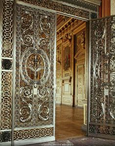 Baroque arts and crafts century. Doors of the Galerie d'Apollon, 1650 - wrought iron and silver. From the Chateau de Maisons Louvre, Departement des Objets d'Art, Paris, France