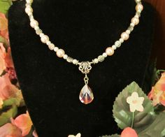 Elegant & Feminine - Pink and White Pearl Necklace with Pink Crystal Pendant. $44.95, via Etsy.
