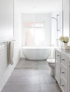 guest bathroom The soft palette of the Guest Bathroom at our project glows with natural light! Styling by megan_morton Photography by Bathtub, Diy Bathroom, Bathroom Inspiration, Small Bathroom Remodel, Guest Bathroom, Bathrooms Remodel, Narrow Bathroom, Luxury Bathroom, Bathroom Renovations