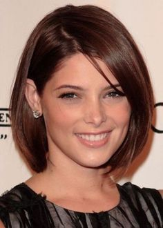 The Twilight Saga actress Ashley Greene looks stylish and poised with her chic, rounded bob. This bob hairstyle is a bit longer than chin length, with rounded ends that give her hair a great shape. Ashley has tucked a section of hair behind her ear, contrasting her long side fringe that conceals the other ear. This bob hairstyle is easy to maintain with regular trims, and weekly hot oil treatments for extra shine.