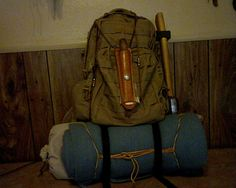 Three day, two night pack. An Inexpencive 511 knock off bag, Axe, Mora Classic #2, Folding Saw, Fire Kit, FAK, Poncho, Cordage, Headlamp, Bandannas X2, Compact Cookset (Bannock, one potato and some dry goods inside), 2qt bladder canteen. 6'x6.75' 100% Blue wool blanket, 10x12 Tan Poly tarp with car screen ground pad. Comfort items: BSA book and journal, instant coffee