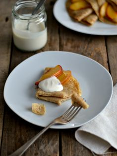Whole wheat flaxseed crepes served with peach and yogurt
