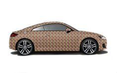 WOW* TV: Audi TT (3rd generation) covered with 27.000 chocolates. Absolutely gorgeous and delicious ! :-)
