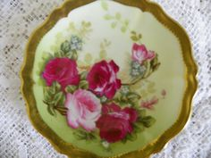 I seek out antique dishes with roses on them.  KO