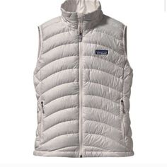 Women's Down Feather Patagonia Vest In great condition, barely worn. It is down feather, great quality like the other Patagonia vests/sweaters/coats! Wasn't my style anymore. That's the only reason why I'm selling! Great paired with a long sleeved shirt and jeans! Perfect for fall season! Patagonia Accessories