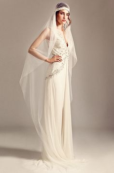 A stunning juliet cap wedding veil with braided detailing from the Temperley, Iris collection hails vintage 1920s glamour.