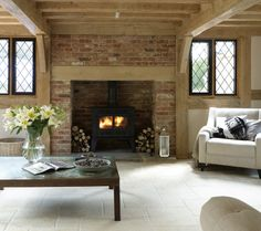 Gorgeous creamy stone fireplace with log burner Log Burner Living Room, Log Burner Fireplace, Cottage Fireplace, Inglenook Fireplace, Fireplace Design, My Living Room, Fireplace Ideas, Brick Fireplaces, Fireplace Kitchen