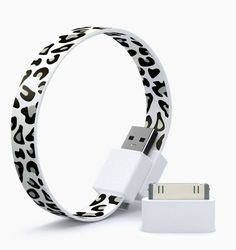 loop -- micro USB/iPod cable. Clips together to attach to a bag, or wrist. Has a bunch of different designs, from colors to animal prints.     $15.99