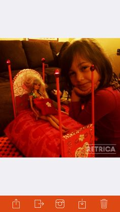 Hiona and her creation 'Barbie bed'