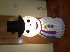 Snowman made of plastic glasses