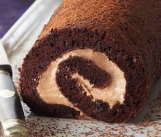 Chocolate Roulade With Coffee Cream: A delectable roulade with dense chocolate and fresh, light cream filling.