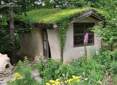 This straw bale music room, dripping in greenery and surrounded by flowers, is in Bethlehem, PA, USA.