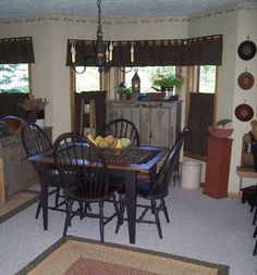 This website has great pics of a prim style home!